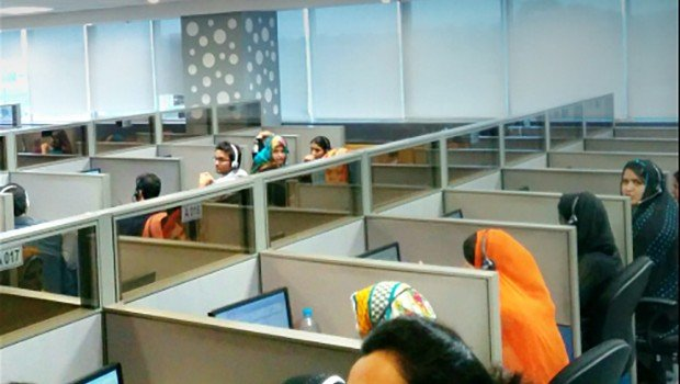 call center in Pakistan, girls sitting, smiling